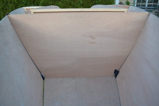 Storer plywood racing dinghy.  Gaffer tape building method leaves interior very clean and fast to fillet/glass tape.
