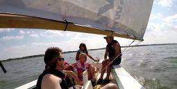 kids learing to sail in an Oz Gooze simple inexpensive sailboat - storer boat plans
